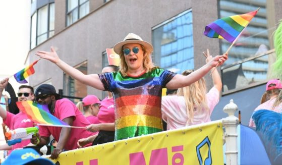 TV personality Marilyn Denis marches with participants on Bloor St. at the 39th Annual Toronto Pride Parade on June 23, 2019, in Toronto.