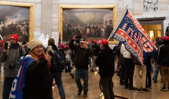 People walk around the Rotunda of the U.S. Capitol during the incursion on Jan. 6.
