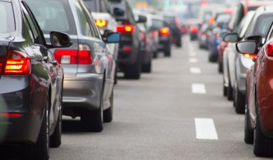Cars are pictured in traffic in the stock image above.
