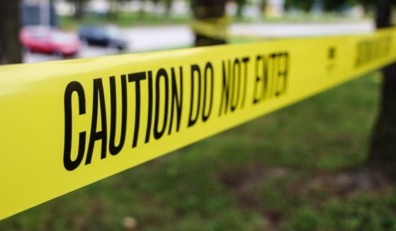 The above stock photo shows caution police tape.