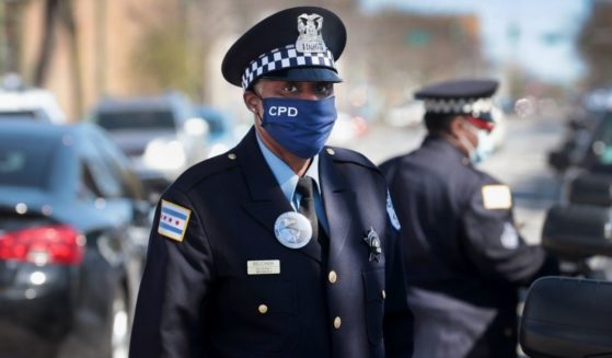 Police officers attend the funeral of Sgt. Clifford Martin, a 25-year veteran of the Chicago Police Department, on April 21, 2020, in Chicago.