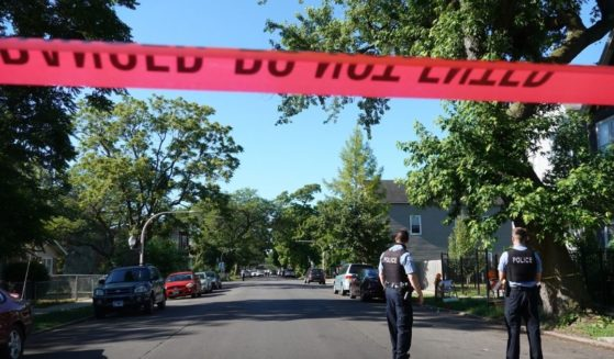 Police secure the scene of a shooting on June 15, 2021, in the Englewood neighborhood of Chicago.
