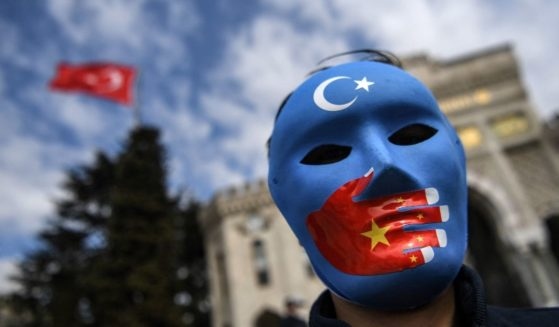 A demonstrator wearing a mask takes part in a protest in support of Uighurs on April 1, 2021, in Istanbul.