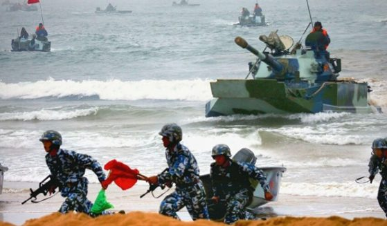 Chinese troops conduct an amphibious landing exercise in waters near Taiwan.