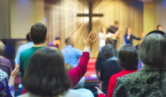 A Christian congregation worships in the stock image above.
