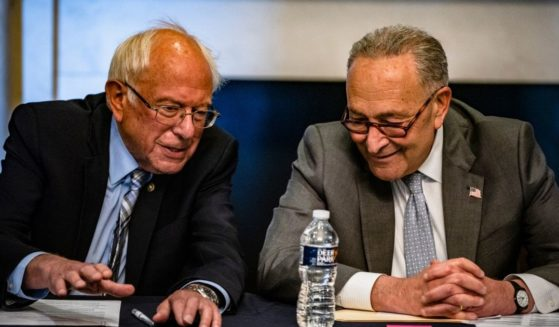 Senate Majority Leader Chuck Schumer, right, and Sen. Bernie Sanders hold a meeting with Senate Budget Committee Democrats at the U.S. Capitol on Wednesday in Washington, D.C.
