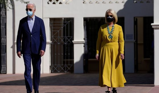 Then-Democratic presidential candidate Joe Biden, left, walks with Cindy McCain as they visit the Heard Museum in Phoenix on Oct. 8, 2020.