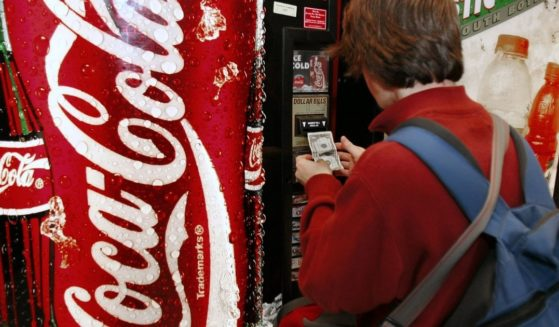 A Student at McLean High School in McLean, Virginia, purchases soft drinks from a vending machine on school property on Dec. 15 2005.