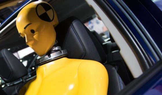 A crash test dummy sits inside a Toyota Corolla as it is shown during the 2017 North American International Auto Show in Detroit on Jan. 10, 2017.
