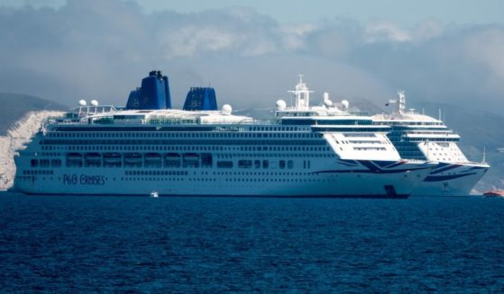 A cruise ship remains anchored in the English Channel off the Dorset coast as the industry remains at a standstill due to the ongoing coronavirus pandemic on June 13, 2021, in Weymouth, England.