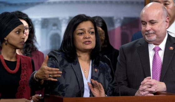 Rep. Pramila Jayapal of Washington, accompanied by fellow Democratic Reps. Ilhan Omar of Minnesota, left, and Mark Pocan of Wisconsin, speaks during a news conference on Capitol Hill in Washington on Jan. 8, 2020.