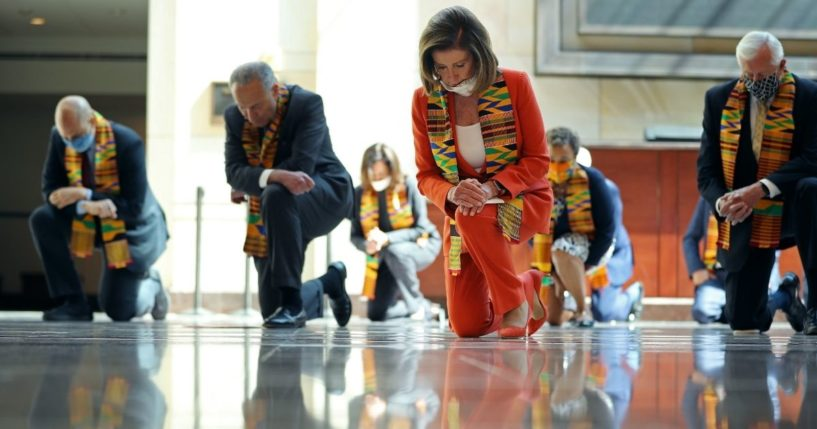 Then-Senate Minority Leader Chuck Schumer, House Speaker Nancy Pelosi and other Democrats kneel for eight minutes and 46 seconds to honor George Floyd in the U.S. Capitol Visitors Center in Washington on June 8, 2020.