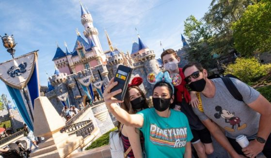 In this handout photo provided by Disneyland Resort, The Wotter family of Lake Elsinore, California, takes a selfie photo in front of Sleeping Beauty Castle as Disneyland Park at the Disneyland Resort on April 30, 2021, in Anaheim, California.