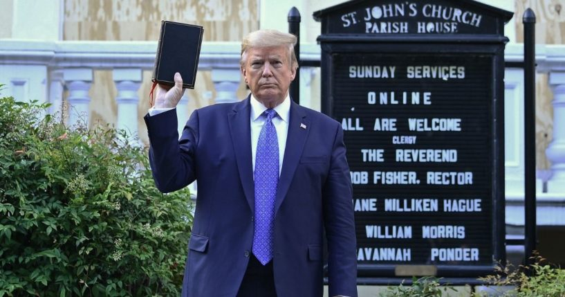 Then-President Donald Trump holds up a Bible outside of St John's Episcopal church across Lafayette Park in Washington, D.C., on June 1, 2020.