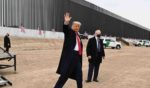 President Donald Trump waves after speaking and touring a section of the border wall in Alamo, Texas, on Jan. 12, 2021.