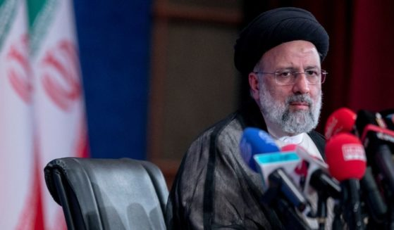 Iranian President-elect Ebrahim Raisi holds a news conference at Shahid Beheshti conference hall in Tehran on Monday.