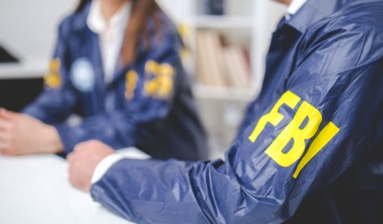 The above stock photo shows two FBI agents working.
