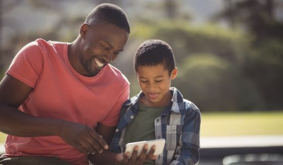 A father and son are pictured spending time together in the stock image above.