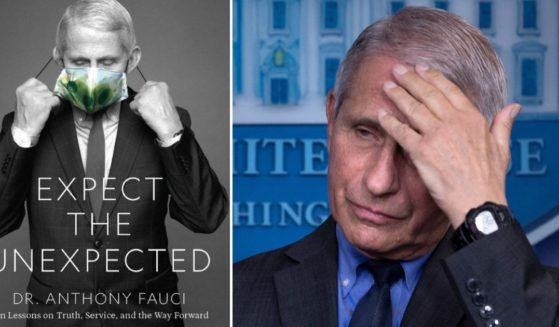 """Anthony Fauci, director of the U.S. National Institute of Allergy and Infectious Diseases, listens to a question during a media briefing at the White House in Washington on April 13. At left is his forthcoming book, """"Expect the Unexpected."""""""