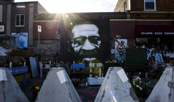 Barricades stand rearranged in front of a portrait at George Floyd Square on Thursday in Minneapolis.