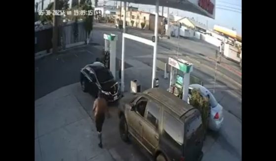 A man identified as 37-year-old Antoine Rainey approaches a woman at a gas station in Gardena, California.
