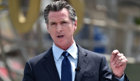 Democratic California Gov. Gavin Newsom attends a news conference for the official reopening of the state of California at Universal Studios Hollywood on June 15, 2021, in Universal City, California.