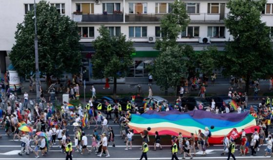 A general view shows people demonstrating with Gay Pride flags during the Gay Pride Parade in central Warsaw on Saturday.