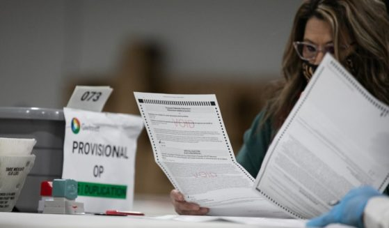 A Gwinnett County election worker looks over absentee and provisional ballots at the Gwinnett Voter Registrations and Elections office on Nov. 6, 2020, in Lawrenceville, Georgia.