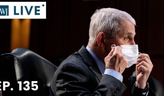 Dr. Anthony Fauci, the director of the National Institute Of Allergy and Infectious Diseases, takes off his face mask during a hearing with the Senate Committee on Health, Education, Labor, and Pensions on the COVID-19 response on Capitol Hill on March 18, 2021, in Washington, D.C.