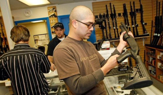 Anthony Del Rosario of Nevada looks at a shotgun at The Gun Store on Nov. 14, 2008, in Las Vegas, Nevada.