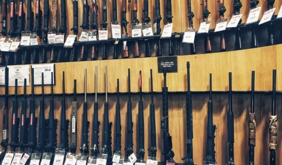 The above stock photo shows a stand with shotguns for sale in the United States.