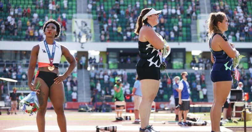 Gwendolyn Berry, third place, looks on during the playing of the national anthem with DeAnna Price, first place, and Brooke Andersen, second place, on the podium after the Women's Hammer Throw final on day nine of the 2020 U.S. Olympic Track & Field Team Trials at Hayward Field on Saturday in Eugene, Oregon.
