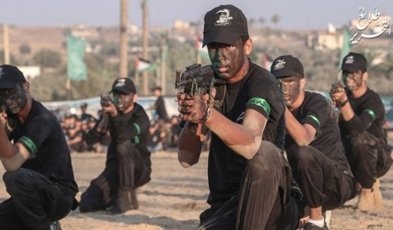In its annual summer camps, Hamas trains children in developing their physique through marches and exercises, in passing through obstacles such as barbed wires and fire hoops, in climbing and in handling firearms, among other things.
