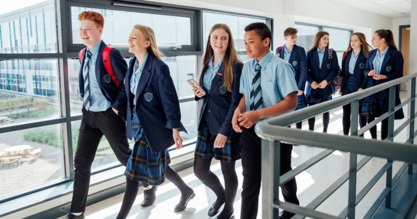 High school students are pictured walking to class in the stock image above.