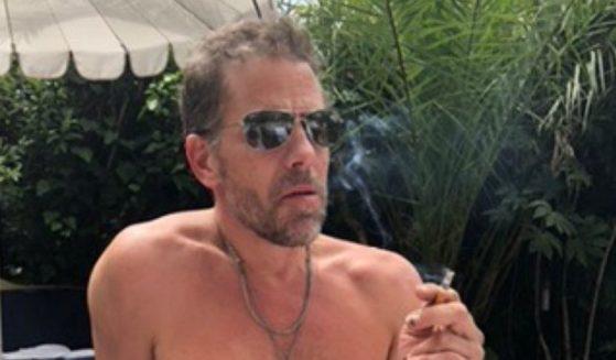 Hunter Biden, the son of President Joe Biden, is seen shirtless smoking a cigarette.
