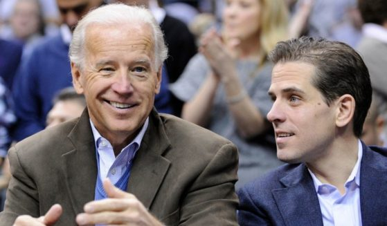 Then-Vice President Joe Biden, left, sits with his son Hunter, right, at the Duke Georgetown NCAA college basketball game in Washington on Jan. 30, 2010.
