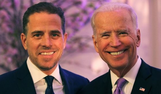 Hunter Biden and his father, then-Vice President Joe Biden, attend the World Food Program USA's annual leadership award ceremony at the Organization of American States in Washington on April 12, 2016.