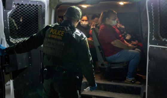Venezuelan immigrants board a U.S. Border Patrol vehicle after crossing the Rio Grande on May 18 in Del Rio, Texas.
