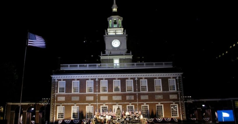 An American flag flies over the building after the re-lighting of Independence Hall on July 3, 2005, in Philadelphia.