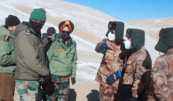 In this photograph provided by the Indian Army, army officers of India and China hold a meeting at Pangong lake region in Ladakh on the India-China border on Feb. 10, 2021.