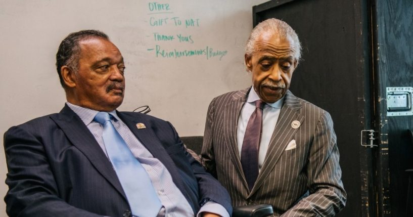 The Rev. Jesse Jackson and the Rev. Al Sharpton spend time together ahead of a rally during commemorations of the 100th anniversary of the Tulsa Race Massacre on Tuesday in Tulsa, Oklahoma.