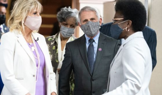 First lady Jill Biden and Dr. Anthony Fauci, director of the National Institute of Allergy and Infectious Diseases, speak with members of Abyssinian Baptist Church on Sunday in New York City.