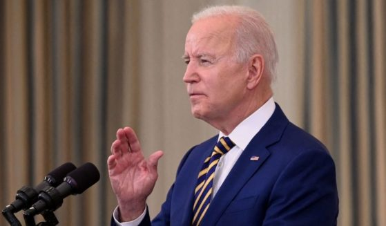 President Joe Biden speaks in the State Dining Room of the White House in Washington on Friday.