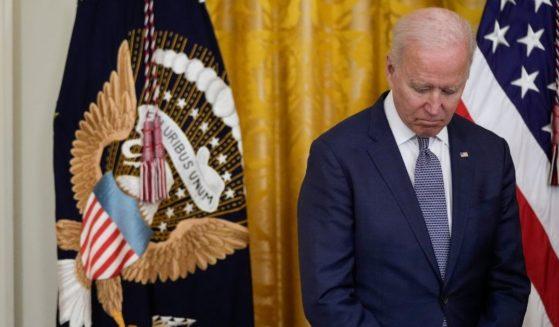 President Joe Biden waits to speak in the East Room of the White House on Thursday in Washington, D.C.