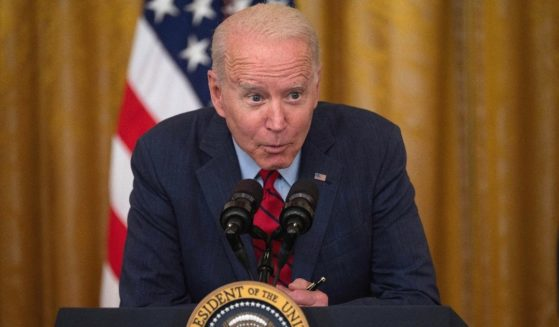 President Joe Biden leans forward and speaks softly during an address in the East Room of the White House in Washington on Thursday.