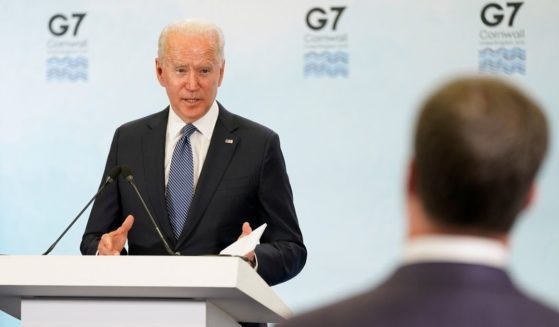 President Joe Biden speaks during a news conference after attending the G-7 summit on Sunday at Cornwall Airport in Newquay, England.
