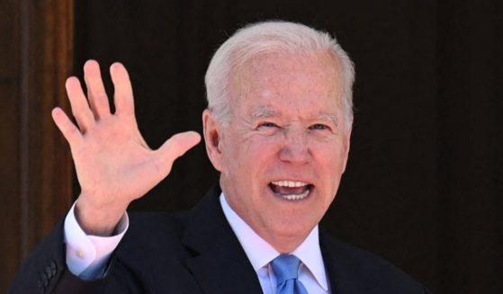President Joe Biden waves at reporters as he arrives at the Villa La Grange in Geneva on Wednesday.