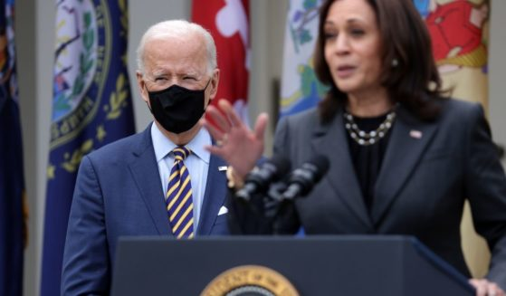 Vice President Kamala Harris, right, speaks as President Joe Biden listens during an event on the American Rescue Plan in the Rose Garden of the White House on March 12, 2021, in Washington, D.C.
