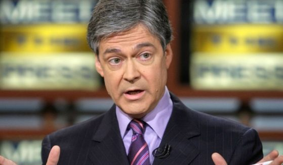 """John Harwood speaks during a taping of """"Meet the Press"""" at the NBC studios on May 11, 2008, in Washington, D.C."""