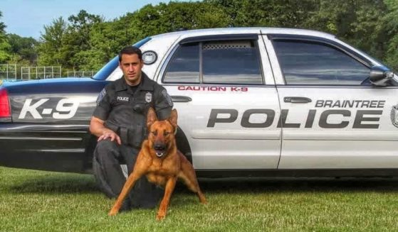William Cushing, Jr. is pictured with Kitt, a Belgian Malinois who was killed in the line of duty earlier this month and has been credited with saving the lives of the three officers he was with.